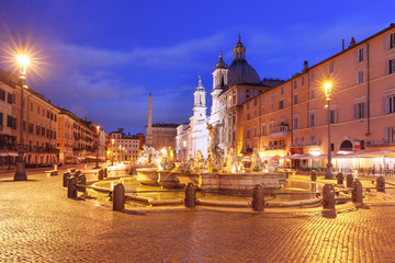 The Fountain of Neptune on the famous Piazza Navona Square at night, Rome, Italy.