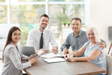 Insurance agents with clients in office