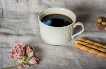 Black coffee with sweet long prong cookies for afternoon snacks.