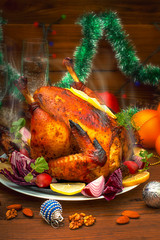 Christmas Dinner. Roasted chicken. Winter Holiday table served. Wooden background. Close-up. Top view