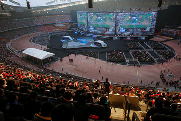 People watch the League of Legends 2017 World Championships Grand Final esports match between Samsung Galaxy and SK Telecom T1 at the Beijing National Stadium in Beijing