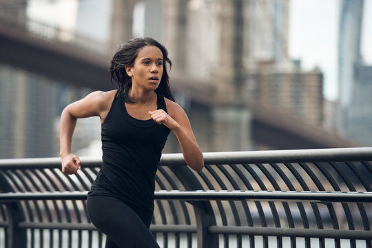 African american woman running in New York City at the morning