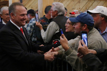 Republican candidate for U.S. Senate Judge Roy Moore greets supporters during a campaign rally in Midland City