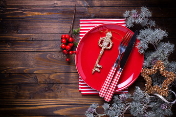 Empty plate, knife and fork, napkin and christmas decorations