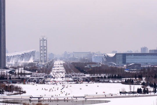 On the first day of snowing, beijing skyline, Beijing Olympic Park distant view