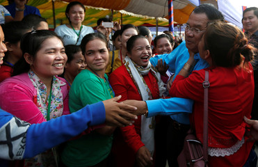 Cambodia's Prime Minister Hun Sen is surrounded by garment workers on the outskirts of Phnom Penh