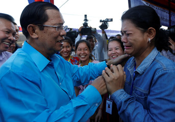 A garment worker cries as as she meet with Cambodia's Prime Minister Hun Sen, on the outskirts of Phnom Penh