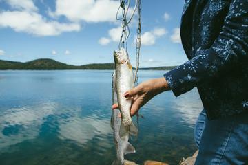 Older Woman Fishing at the Lake