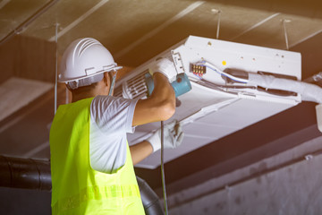 Male technician Maintenance of indoor air conditioners.