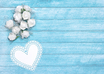 Small white flowers and paper heart with free space for text