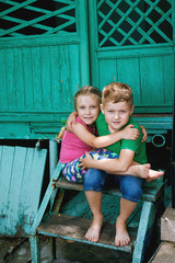 Boy and girl on a summer outing . Children's friendship