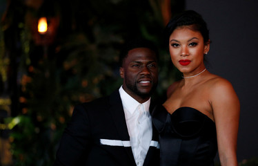 "Cast member Hart and his wife Eniko Parrish pose at the premiere for ""Jumanji: Welcome to the Jungle"" in Los Angeles"
