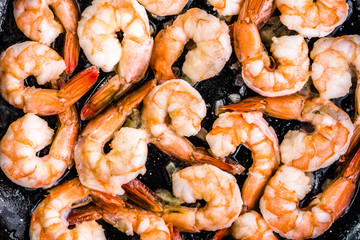 Background with shrimp on platter, preparing dish with seafood, mediterranean food concept