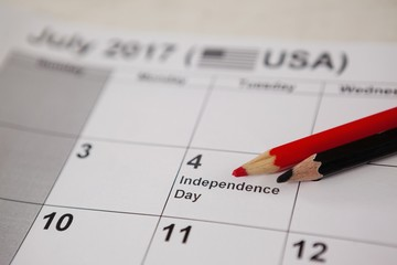 Colored pencil with fourth of july calendar