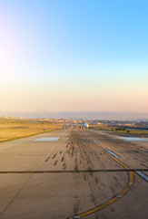 Planes on airport runway in the morning.