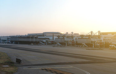 Airport terminal docks at morning sunrise.