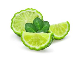 sliced fresh bergamot with green leaves isolated on white background