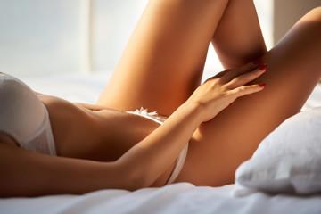 Female body close up. Slim girl in bed.