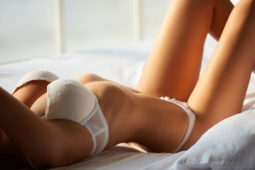 Woman in bed. Sexy girl in underwear.