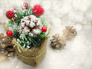 christmas decoration winter berries and snow on wooden background