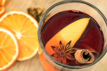 Mulled wine in night celebration of  New Year party and delicious Christmas drink for autumn and a winter season , top view or overhead shot