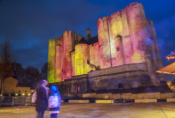 Illuminations of Christmas and light projection on the face of the dungeon on the main square of downtown niort