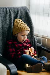 Little boy with garland illumination