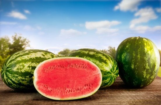 Sliced watermelon with whole watermelons