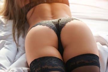 Sexy butt, black panties. Woman in lingerie close up.
