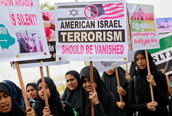 Women hold up placards during a protest in Colombo, Sri Lanka, against U.S. President Donald Trump and the U.S. decision to recognise Jerusalem as the capital of Israel