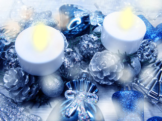 christmas candles decoration and snow on wooden background