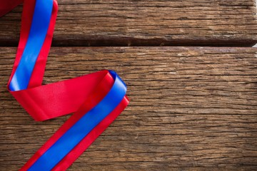 Red and blue ribbon on wooden table