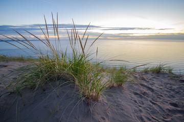 Summer Nights. Dune grass on the edge of a massive sand dune at twilight on the shores of Lake Michigan. Sleeping Bear Dunes National Lakeshore, Michigan, USA.