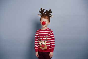 I am so cute boy in reindeer costume