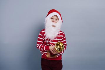 Child wearing santa hat and beard.