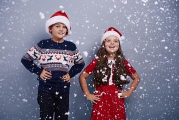 Portrait of siblings among snow falling