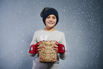 Front view of boy with christmas gift