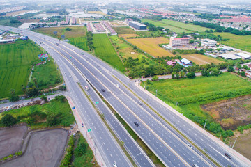 Motorway traffic junction road surrounded by green tree
