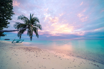 Tropical beach sunset, calm sea, sunset sky and clouds