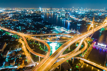 Aerial top view night traffic bridge river side with city