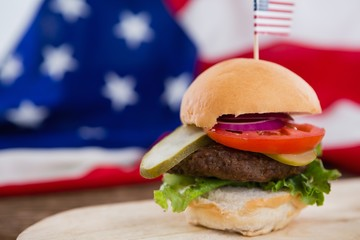 Burger on wooden table with 4th july theme
