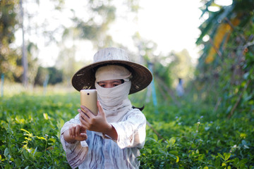 Close up shot farmer using mobile smartphone in the nature farm