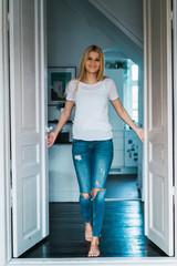 Cheerful woman in doorway