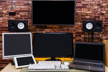 many blank screen of electronic devices on working space for technology background