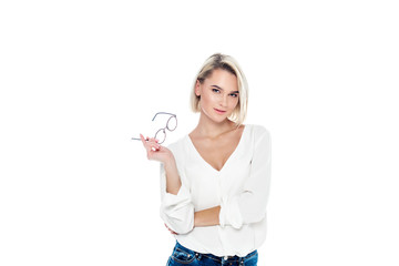 attractive blonde woman posing with glasses, isolated on white