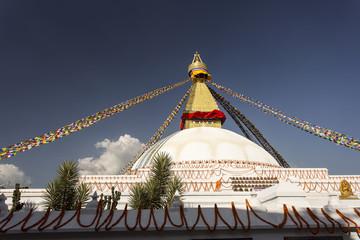 Boudhanath stupa in Kathmandu, Nepal. The Buddhist stupa of Boudhanath dominates the skyline, it is one of the largest stupas in the world