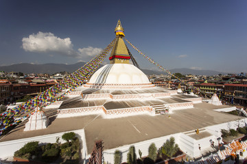 Boudhanath stupa in Kathmandu, Nepal. The Buddhist stupa of Boudhanath dominates the skyline, it is one of the largest stupas in the world