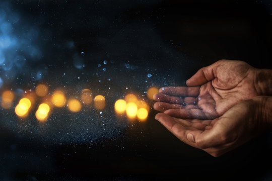 closeup hands of man begging for help. concept for poverty or hunger, seeking for light in the dark.