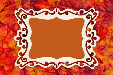 Autumn time with fancy wood frame and fall leaves