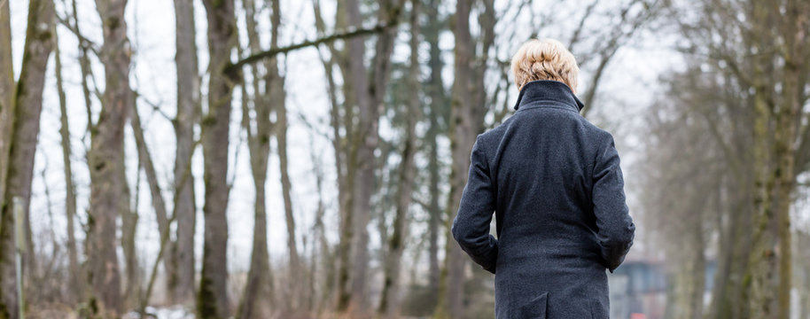 Unhappy woman having walk in winter park